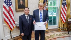 President Trump holds an  a letter from North Korean leader Kim Jong Un, delivered to him by North Korean envoy Kim Yong Chol in the Oval Office on Friday. (Shealah Craighead/The White House)