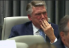 Congressional candidate displays emotion in ballot fraud hearing.