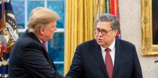 AG William Barr shakes hands with Donald Trump in the Oval Office